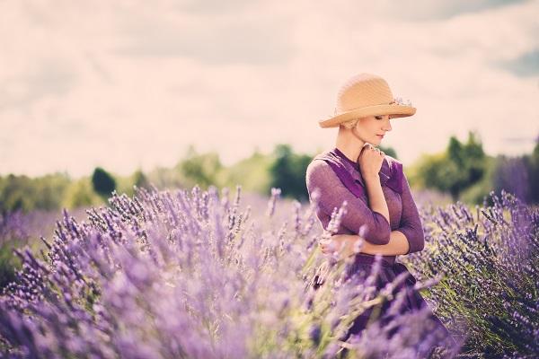 Enigmatic Ukrainian woman in a purple dress and hat in a lavender field