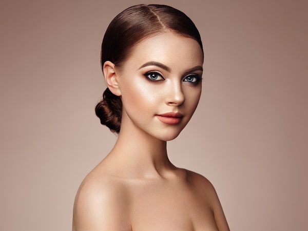 Beautiful young Ukrainian woman posing for the camera with perfect makeup on her face